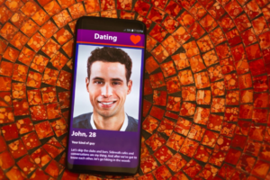 Dating app displaying the photo of a handsome man