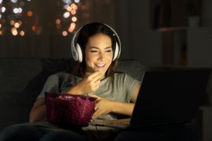Woman watching video on netflix clone app